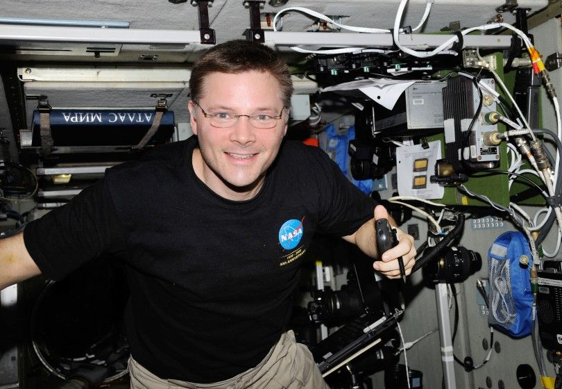 ISS024-E-013387 (5 Sept. 2010) --- NASA astronaut Doug Wheelock, Expedition 24 flight engineer, uses a ham radio system in the Zvezda Service Module of the International Space Station.