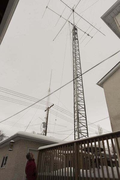 Drury looks up at his antennas tower in his backyard. His antennas allow worldwide communication. (Jesse Boily / Winnipeg Free Press)</p>
