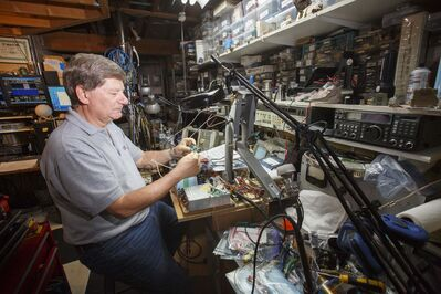 Barry Malowanchuk uses his station, among other purposes, to bounce signals off the moon to communicate with other hams, testing his ability to build sensitive receivers and effective antennas. (Mike Deal / Winnipeg Free Press files)</p>